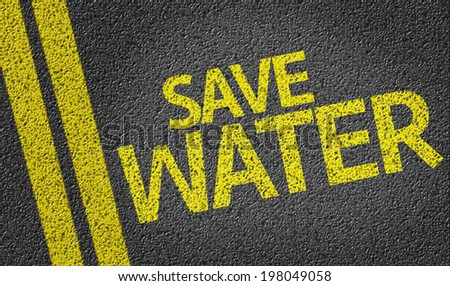 Save Water written on the road - stock photo