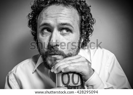 Saver, man with intense expression, white shirt - stock photo