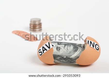 Saving Account. Photo Shows a 100 Dollar Bill Inside an Egg by Saving Coins.