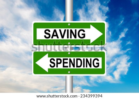 Saving and Spending Road Signs with a blue sky in a background - Choosing save or spend money. - stock photo