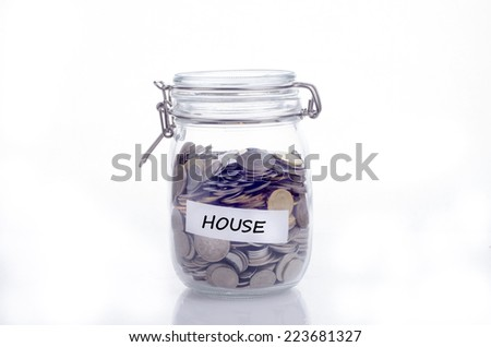 Saving concept for house: Conceptual by jar with coin