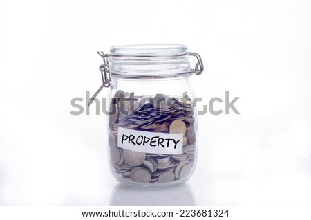Saving concept for property: Conceptual by jar with coin