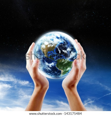 Saving Earth concept, Hands holding Earth with a sky and space background. Elements of this image furnished by NASA - stock photo