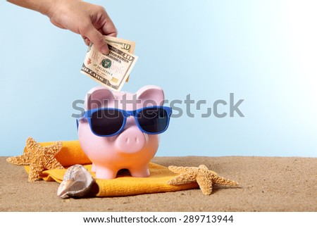 Saving for summer beach vacation, piggy bank, sunglasses. Copy space. - stock photo