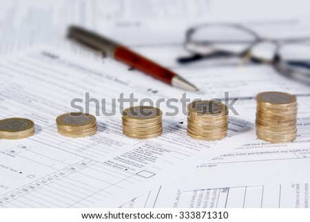 Saving money concept - Growing savings. Growing coin stack