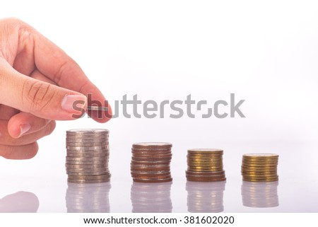 Saving money concept,Male hand putting money coin stack growing business