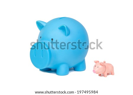 Saving money, hand putting coin into piggy bank