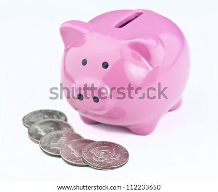 saving money in a piggy bank - stock photo