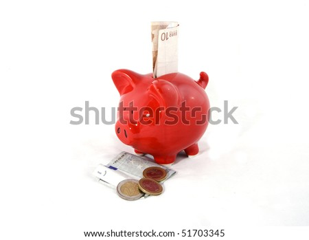 Saving money in a red pig on a white background. - stock photo
