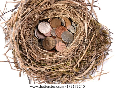 saving pennies for the future in a nest egg isolated on white - stock photo
