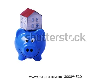Saving plan concept with Piggy bank and house paper on above