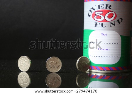 Saving , this is a still life depicting the concept of putting money aside for the future, and at a stage of life when this becomes important. - stock photo
