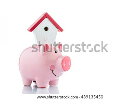 Saving to buy a house, piggy bank and house