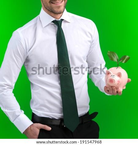 Savings. Businessman holding a Piggy Bank - stock photo