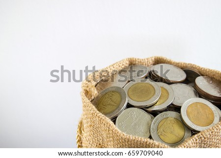 Savings coins in sack. Show Stock asset investment, Retirement plan, Pension fund, 401K, Passive income, Wage, Millionaire, Financial freedom and wealth increment, Budget and tax plan, rich concept.