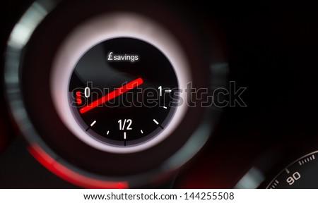Savings fuel gauge nearing empty. - stock photo