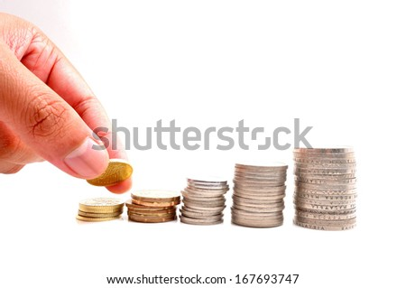 Savings, increasing columns of coins isolated on white background