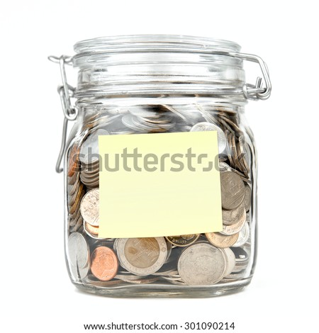Savings money box coins thai baht with empty yellow stick note paper isolated on white background. Jar for savings full of coins. Piggy bank for saving money template for text. Close up. Front view. - stock photo