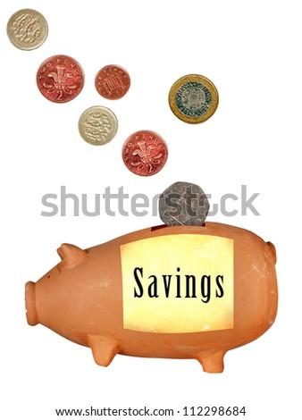 Savings money box, piggy bank - UK, isolated over white - stock photo