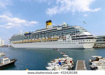 "Savona, Italy - September 27, 2015:cruise ship ""Costa Fascinosa"" leaves the port of Savona for a cruise in the Mediterranean, with a passenger capacity of 3,800 people"