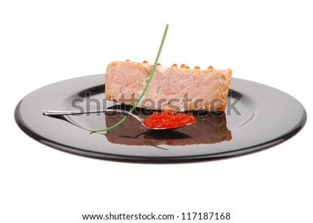savory fish : norwegian salmon fillet roasted with green onion pen , red caviar in spoon , on black dish isolated over white background - stock photo