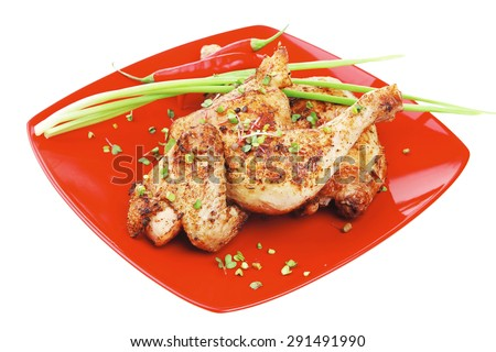 savory food : roasted chicken legs garnished with green sprouts and peppers on red plate isolated over white background - stock photo