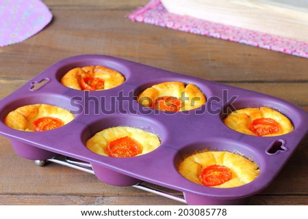Savory mini cakes with roasted cherry tomatoes - stock photo