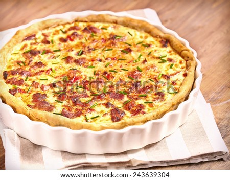 Savory pie with chicken, bacon, onion and pepper - stock photo