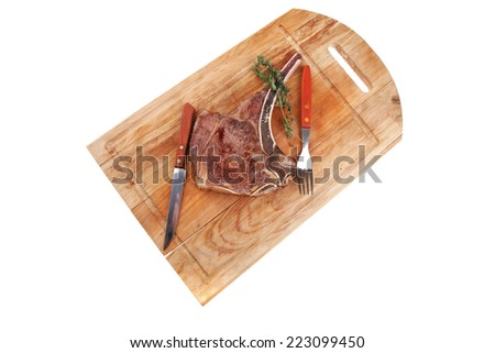 savory : roasted beef spare rib on wooden plate with cutlery and thyme isolated over white background - stock photo