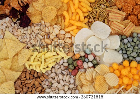 Savory snack food selection forming an abstract background. - stock photo
