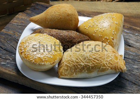Savory traditional in Brazil, pie, kebab, drumstick, pastel. - stock photo