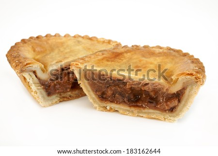Savoury meat pie with a beef filling studio isolated - stock photo
