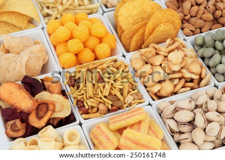 Savoury snack party food selection in square porcelain bowls. - stock photo