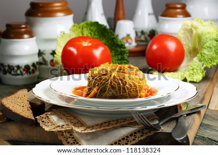 Savoy cabbage stuffed with meat on a white plate.