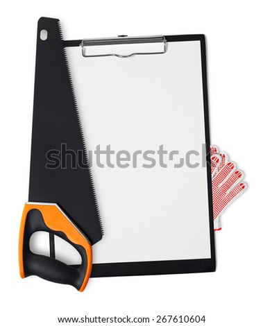 Saw and gloves on clipboard - stock photo