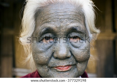 SAW, MYANMAR, DECEMBER 10: Chin tribe tattooed woman (Uppriu) poses for a photo on December 10, 2015 Saw, Myanmar. Also known as the Kakis they are a number of Tibeto-Burman tribal people.