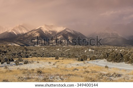 Sawatch Mountain Range Covered in Freshly Fallen Snow with Passing Storm - stock photo