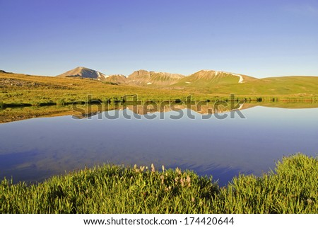 Sawatch Range Reflection in Calm Lake, Rocky Mountains, Colorado - stock photo