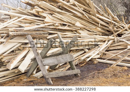 Sawbuck on pile of firewood background