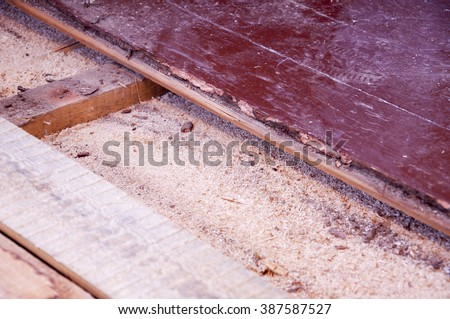 Sawdust insulation under old floor boards