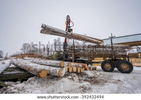 Sawmill in winter. Image of truck loading timber - stock photo
