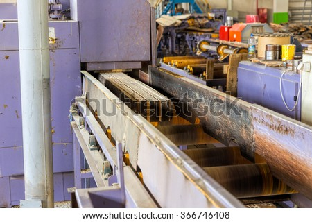 Sawmill. The process of cutting logs into boards. Automatic line sawing - stock photo