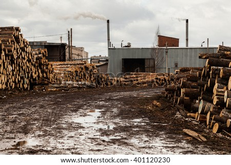 Sawmill with mudy road and lots of logs industrial