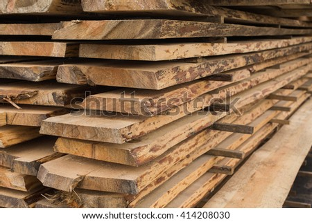 sawmill, wood processing, timber drying, timber harvesting, drying boards, baulk,  work at the sawmill, dead trees, production, yellow wood is dried in a sawmill, wood, timber  - stock photo