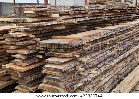 sawmill, wood processing, timber drying.  timber harvesting, drying boards, baulk, work at the sawmill, dead trees, production, yellow wood is dried in a sawmill, wood processing plant   - stock photo
