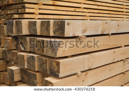 sawmill, wood processing, timber drying, timber harvesting, drying boards, baulk, work at the sawmill, dead trees, production, yellow wood is dried in a sawmill, wood processing plant, manufacture     - stock photo