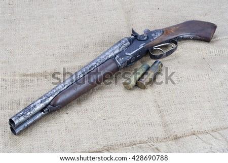 Sawn-off shotgun with cartridges - stock photo