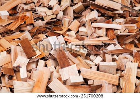 sawn wood cut piled perfectly as backround - stock photo