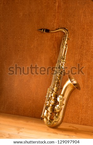 Sax golden tenor saxophone in vintage retro background - stock photo