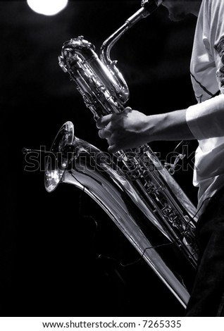 sax player on stage during jazz festival - stock photo